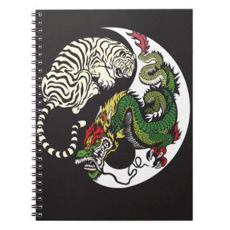 green dragon and white tiger yin yang symbol notebooks