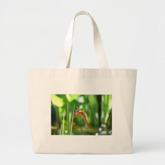 Green Grass behind Orange Dragonfly Tote Bag