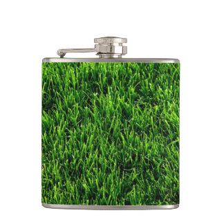 Green grass texture from a soccer field hip flask