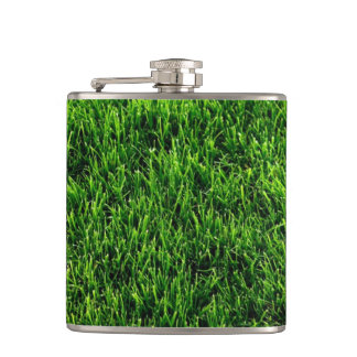 Green grass texture from a soccer field hip flask
