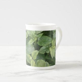 green leaves tea cup
