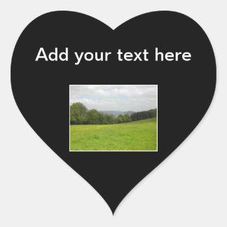 Green meadow. Countryside scenery. Heart Sticker