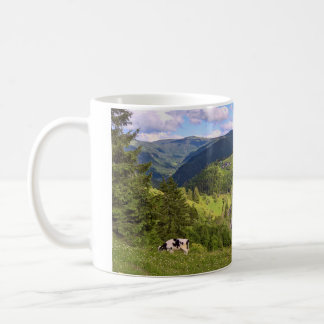 Green Meadows and a cow with panorama view Coffee Mug