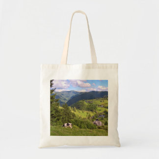 Green Meadows and a cow with panorama view Tote Bag