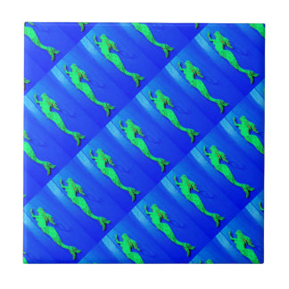 green mermaids on blue tile