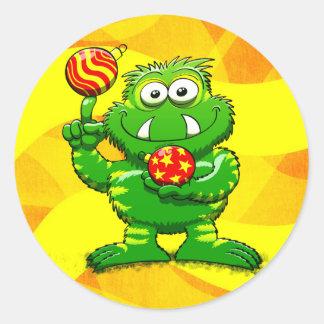 Green Monster Celebrating Christmas Round Sticker