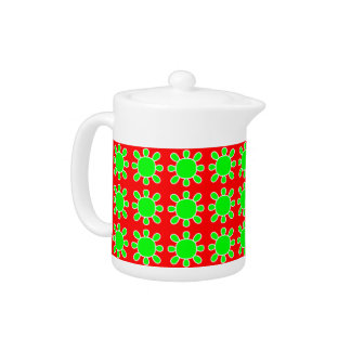 Green on red sun design teapot