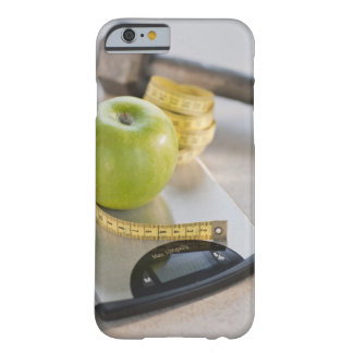 Green on weight scale, tape measure and barely there iPhone 6 case