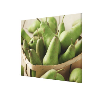Green Pears in Punnet and Wooden Table Canvas Print