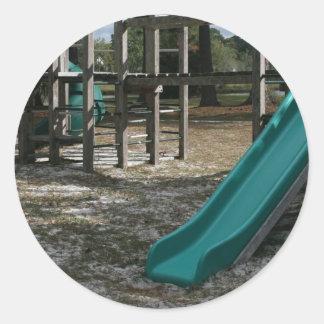 Green Playground slide, wood jungle gym Round Sticker