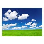 Green rolling hills under blue sky card