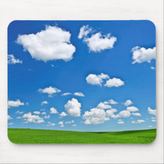Green rolling hills under blue sky mousepads