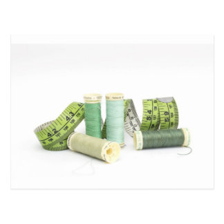Green sewing kit and threads postcard