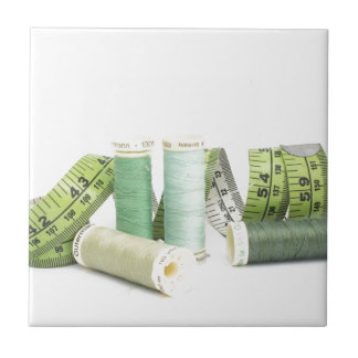 Green sewing kit and threads tiles