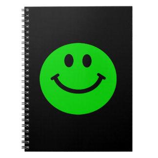 green smiley face notebook