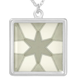 Green star on green and white necklace