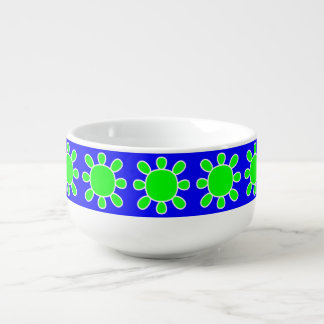 Green sun on blue soup bowl
