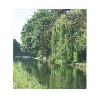 Green sunny spring day green trees river walk notepad