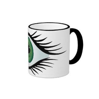 green surprised eye coffee mug