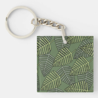 Green Tropical Leaves on Dark Green. Key Ring