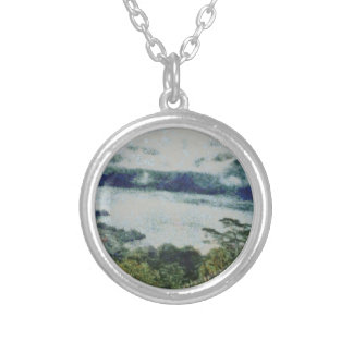 Greenery on shore of a lake round pendant necklace