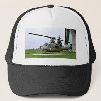 Grey Helicopter in green landscape Trucker Hat