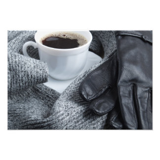 Grey wool scarf and leather gloves photo