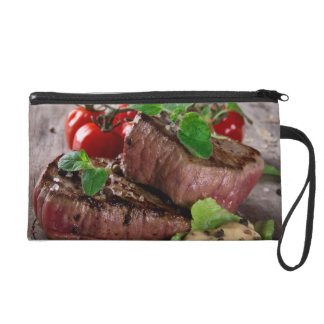Grilled bbq steaks with fresh herbs and tomatoes wristlets