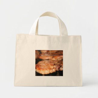 Grilled pork chops on the bbq close up photo bags