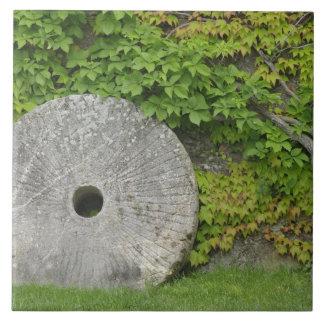 Grinding stone, Castle Banfi in Tuscany region, Tile