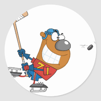 Grinning Bear Playing Ice Hockey Classic Round Sticker