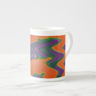 Groovy orange tea cup