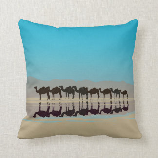 Group of camels walking in desert pillows