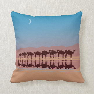 Group of camels walking in sahara pillow