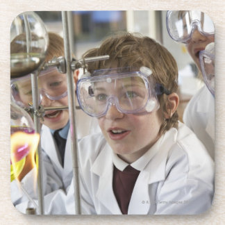 Group of children (9-12) watching experiment in beverage coaster