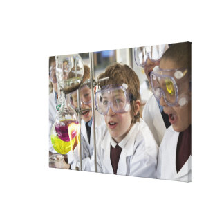 Group of children (9-12) watching experiment in canvas print
