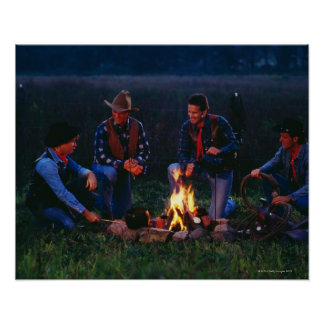 Group of cowboys around campfire poster