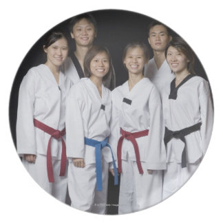 Group of martial arts player standing and party plates