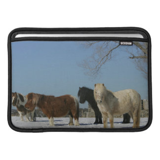 Group of Miniature Horses in the Snow MacBook Sleeve