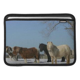 Group of Miniature Horses in the Snow MacBook Sleeves