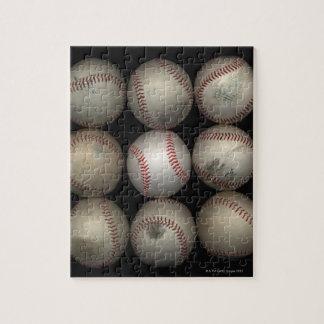 Group of old baseballs on black background jigsaw puzzle