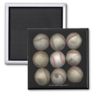 Group of old baseballs on black background magnet