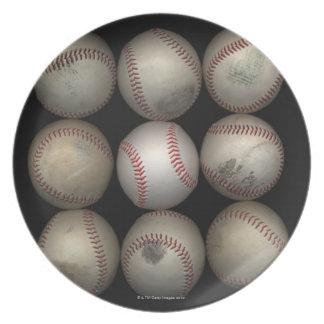 Group of old baseballs on black background plate