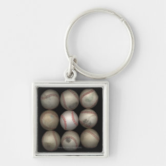 Group of old baseballs on black background Silver-Colored square key ring