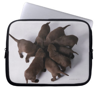 Group of puppies with heads together laptop sleeve
