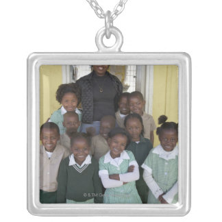 Group of schoolchildren standing with their silver plated necklace