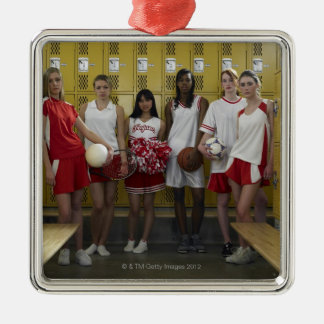 Group of teenage girls (15-17) standing in christmas ornament
