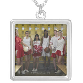 Group of teenage girls (15-17) standing in square pendant necklace