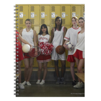 Group of teenage girls (15-17) standing in spiral notebook