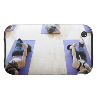 Group of woman stretching on mats in a bright, tough iPhone 3 cover